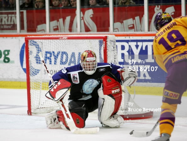 KARLSTAD, SWEDEN - DECEMBER 16, 2004. Peter Nordstrom #19 of Farjestads BK attempts to score on goalie Dominik Hasek #39 of the Worldstars during the game at the Lofbergs Lila Arena. Farjestads BK won the game 6-1.jpg