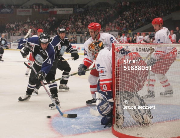 KATOWICE, POLAND - DECEMBER 22, 2004. Forward Tony Amonte #11 of the Worldstars is unable to score on goalie Tomasz Jaworski #30 of the Polish National Team at the Spodek Arena. The Worldstars won in the shootout.jpg
