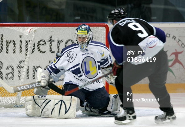 PLZEN, CZECH REPUBLIC - DECEMBER 13, 2004. Alexandre Daigle #9 of the Worldstars is denied by Roman Malek #45 of HC Lasselsberger at The Plzen City Arena in Plzen, Czech Republic. The Worldstars won the game 8-3.jpg