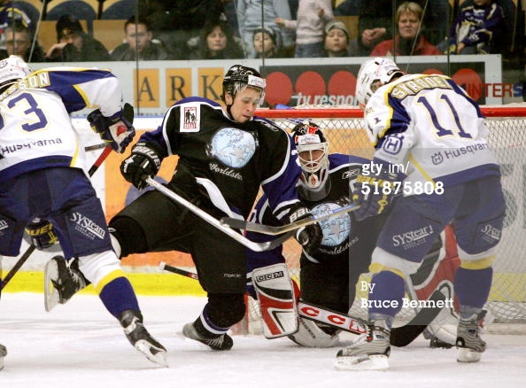 JONKOPING, SWEDEN - DECEMBER 17, 2004. John-Michael Liles #26 and Martin Brodeur #30 of the Worldstars combine to stop Per-Age Skroder #11 of the HV71 at the Kinnarps Arena. The Worldstars won the game 5-1.jpg