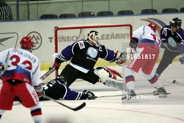 ST. PETERSBURG, RUSSIA - DECEMBER 12, 2004. Marty Brodeur #30 of the Worldstars is beaten by Dmitri Ryabykin #11 of the Russian All-Stars at Yubileyniy Arena in St. Petersburg, Russia.jpg