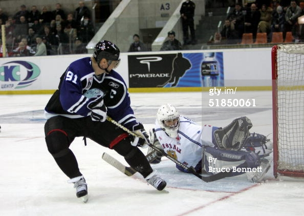 MOSCOW - DECEMBER 11, 2004. Forward Sergei Fedorov #91 of the Worldstars is stopped by goalie Alexander Eremenko #20 of the Russian All-Stars at the Malaya Arena. The Russian All-Stars defeated the Worldstars 5-4.jpg