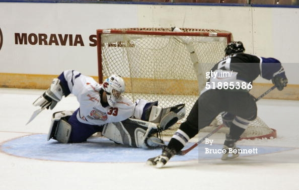 OSLO - DECEMBER 21, 2004. Alexandre Daigle #9 of the Worldstars scores the insurance goal against Soren Petersson of the Norwegian All-Stars at the Olso Spektrum. The Worldstars won the game 7-6.jpg