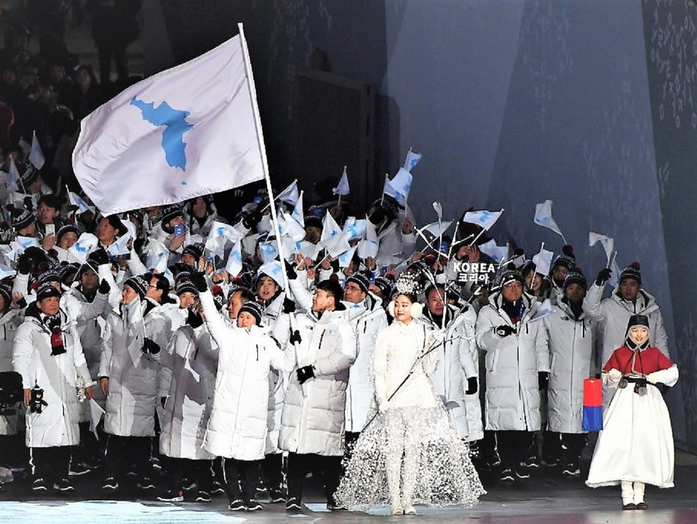 Olympics Open with Koreas marching together.jpg
